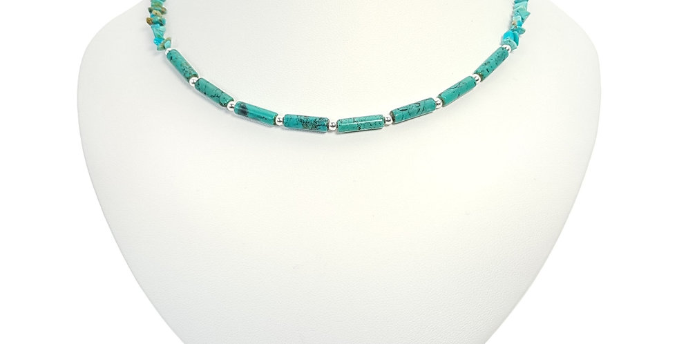 turquoise and sterling silver necklace on display bust