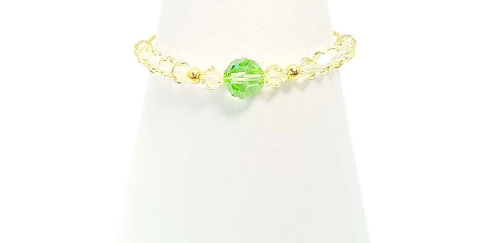 yellow gold plated sterling silver and Swarovski crystals adjustable bracelet on stand