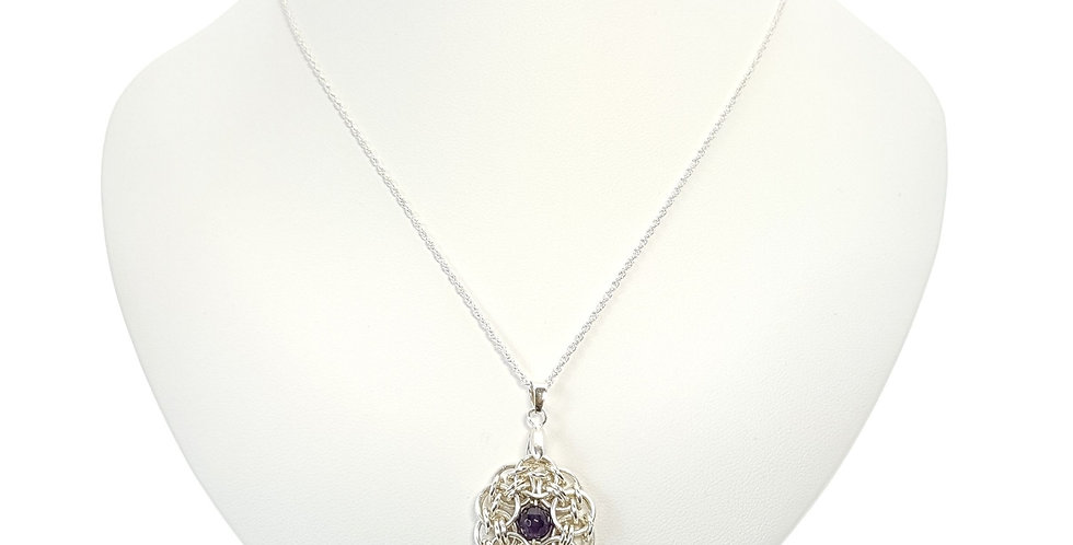Amethyst and Sterling Silver Pendant and Chain on display bust