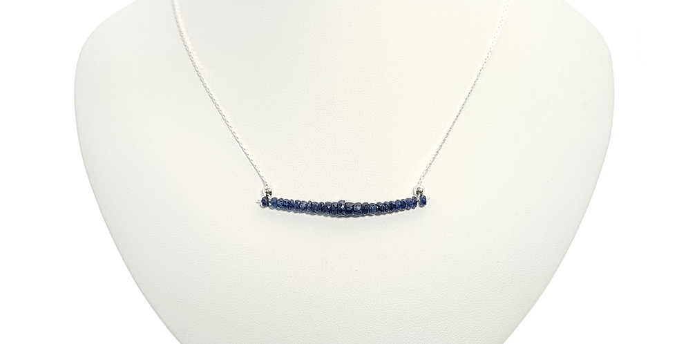 blue sapphire and sterling silver necklace on display bust