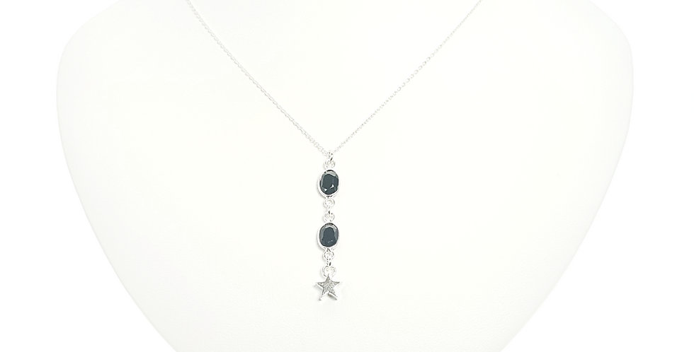 black spinel pendant with sterling silver chain on display bust