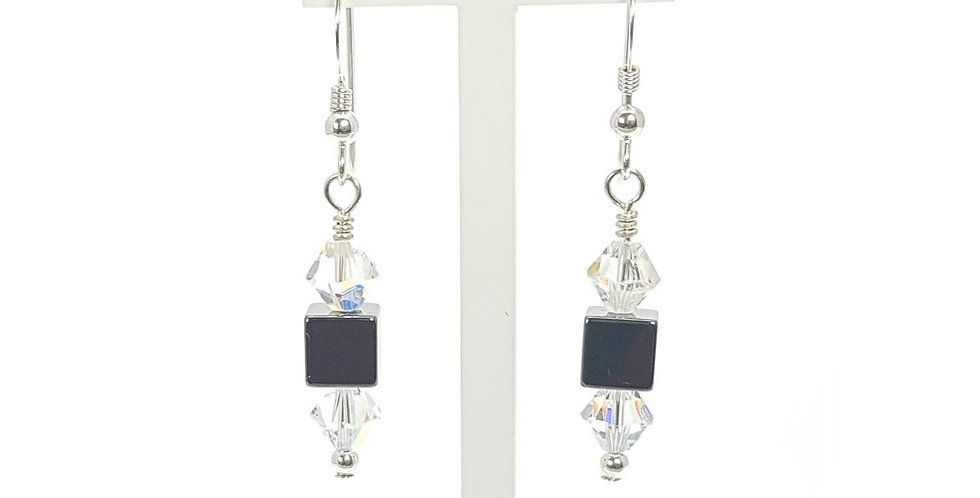 Hematite, Swarovski Crystals and Sterling Silver Earrings on display stand