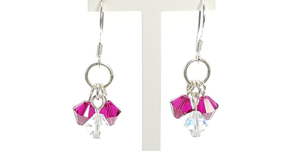 Sterling Silver and Ruby Red Swarovski Crystals Earrings on display stand