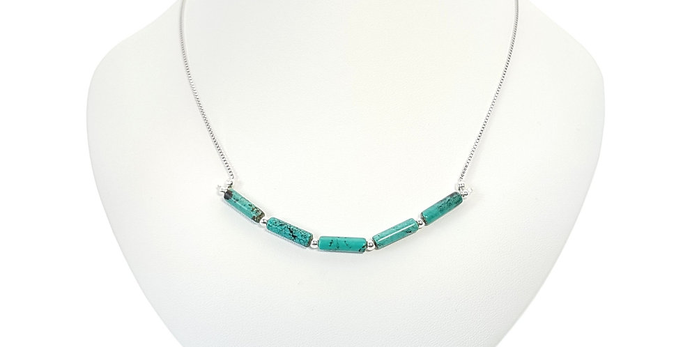 turquoise and sterling silver bar necklace on display bust