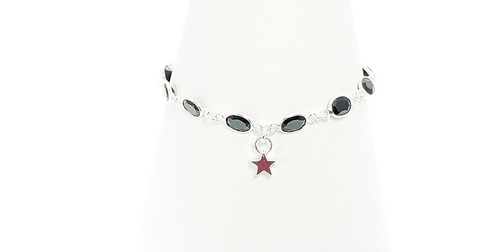 front view of black spinel star charm bracelet