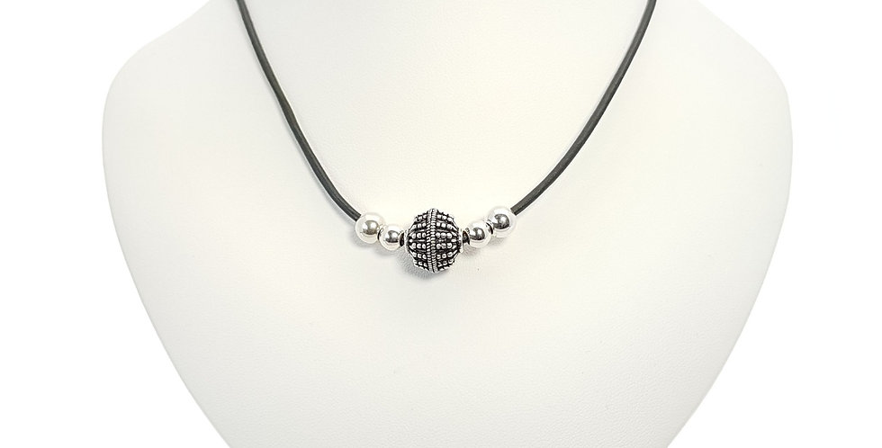 Black leather and sterling silver necklace on display bust
