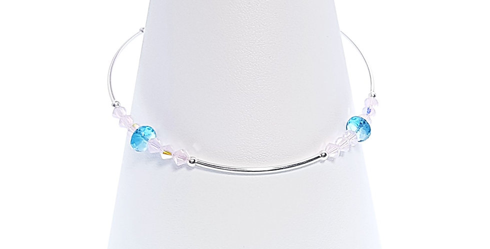 Swiss Blue Topaz, sterling silver and Swarovski crystals stacker bracelet on stand