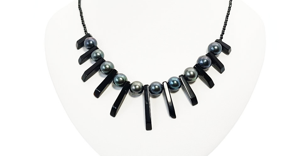 Peacock Pearls, Black Agate and Sterling Silver Necklace on display bust