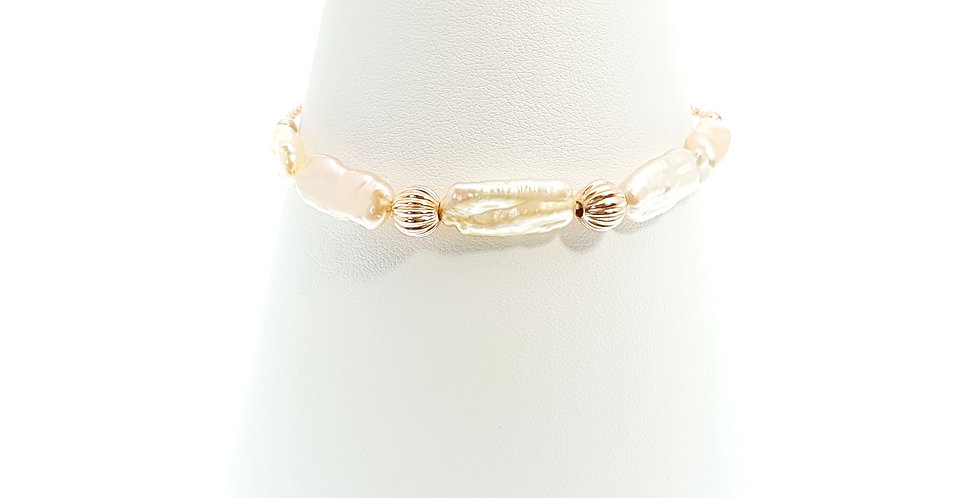 Biwa pearls and rose gold plated sterling silver adjustable bracelet on stand