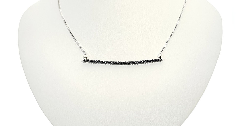 black spinel and sterling silver bar necklace on display bust