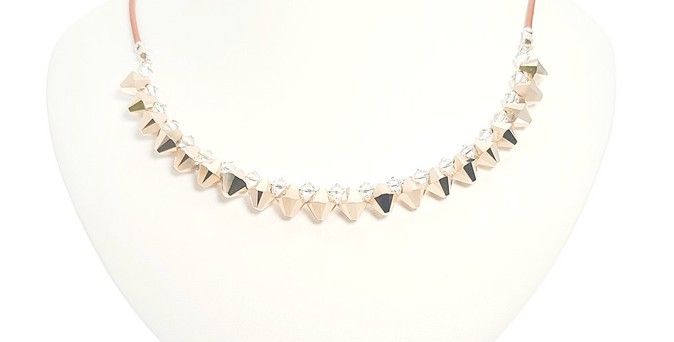 Swarovski crystal, sterling silver and leather necklace on display stand
