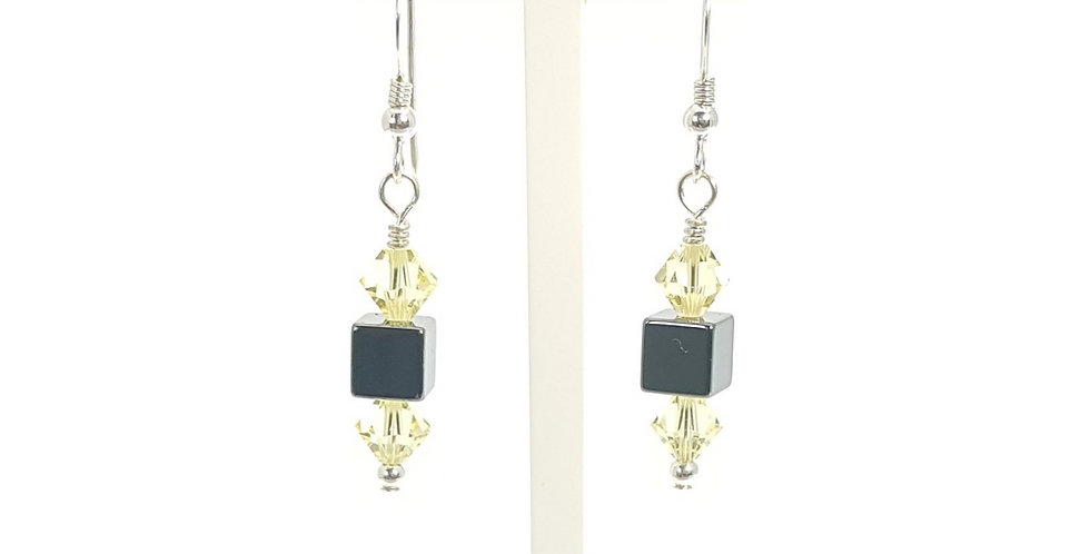 Hematite, Lemon Swarovski Crystals and Sterling Silver Earrings on display stand