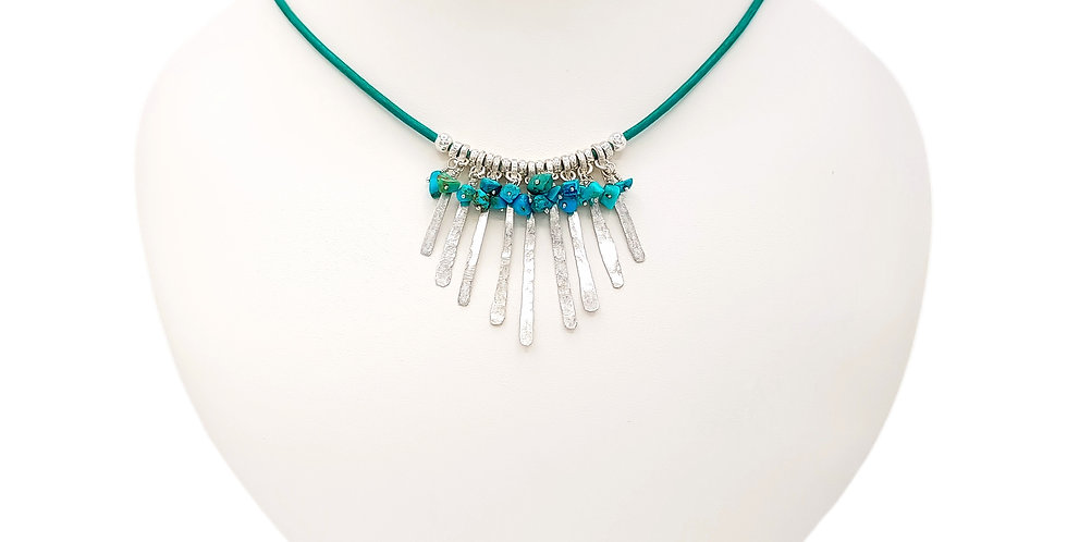 turquoise sterling silver necklace on display bust