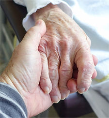 Zoomed In Picuture Of Senior Hand Holding.