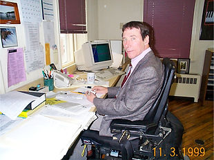 Side View Of Man Sitting At Desk. Photo Dated November 3rd, 1999.