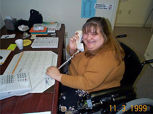 Woman Sitting At Desk While On the Phone. Photo dated November 3rd, 1999.