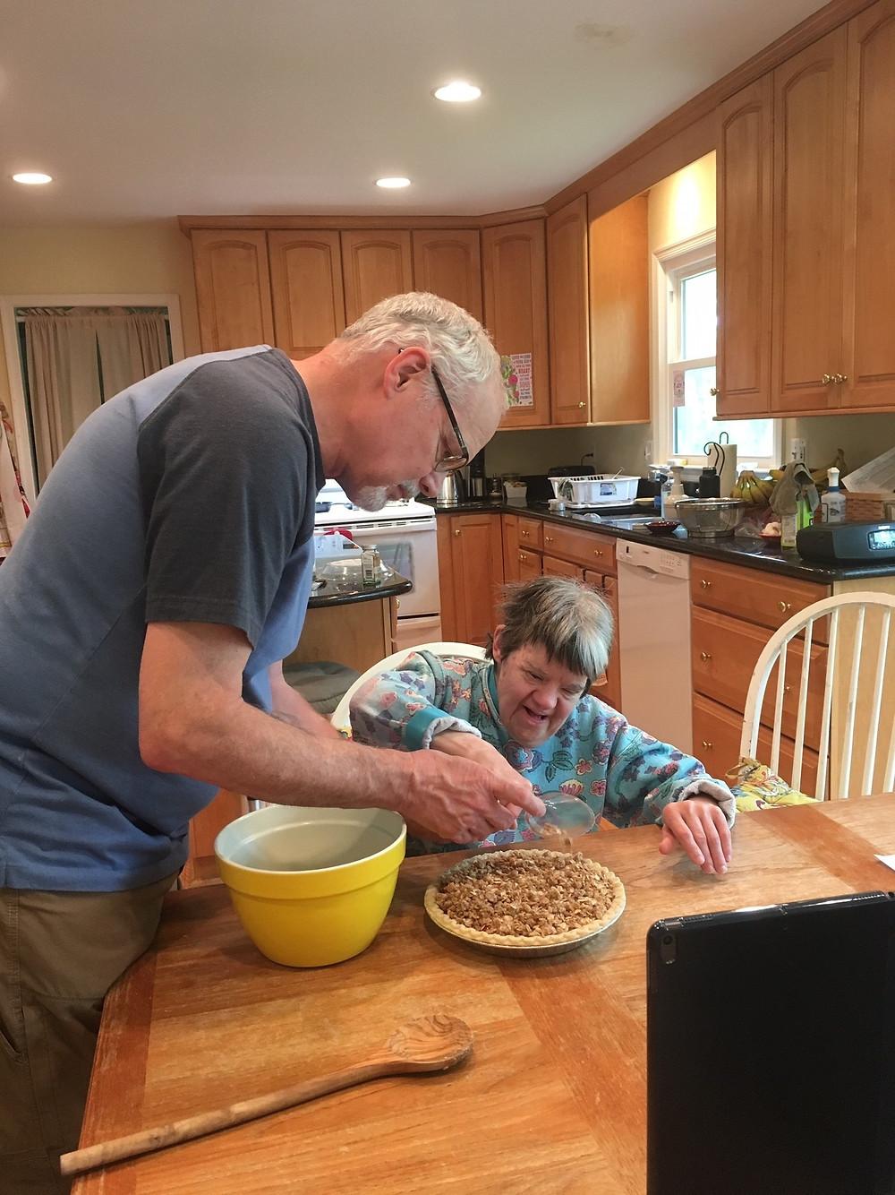 Diane and caretaker, Jim, make a chocolate pie.