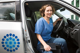 Healtvision nurse getting out of car