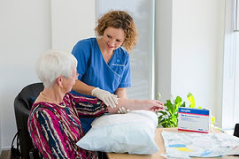 Healthvision Wound Care Nurse caring for client