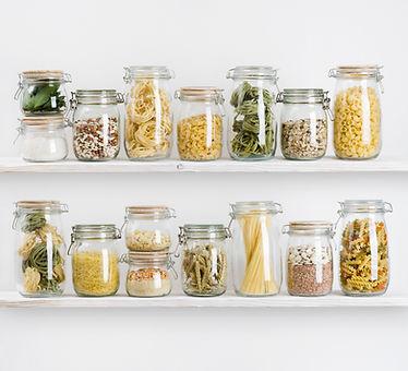 Various uncooked groceries in glass jars