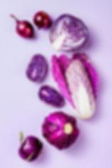 Purple vegetables on pastel color backgr