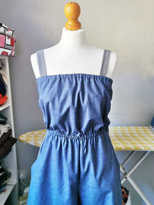 Made to Order denim playsuit with contrasting straps on a mannequin.