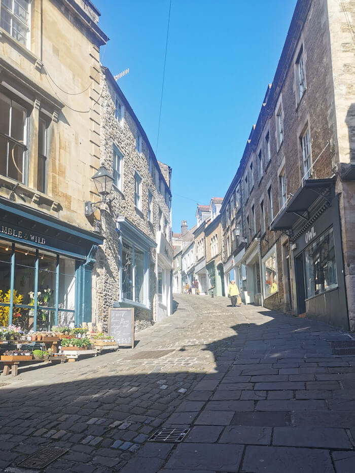 A view from the bottom of the steep cobbled Catherine Hill in Frome, Somerset.