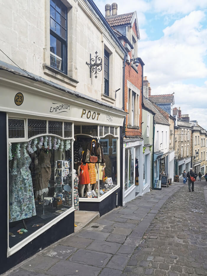 A view from outside clothing shop Poot Emporium on Catherine Hill, Frome, Somerset.