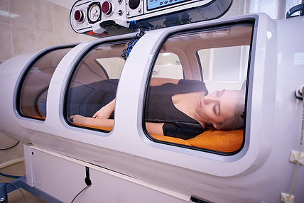 An image of a woman in a hyperbaric oxygen machine