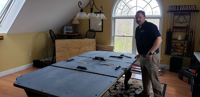 Jeff Robitaille, owner of Maine Pool Table Services assembling pool table