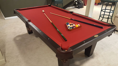 8ft pool table with pool sticks and balls