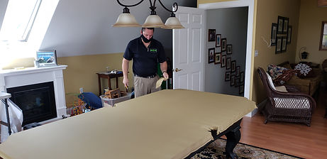 Pool table being re-felted by Jeff Robitaille, owner of Maine Pool Table Services, located in Maine.
