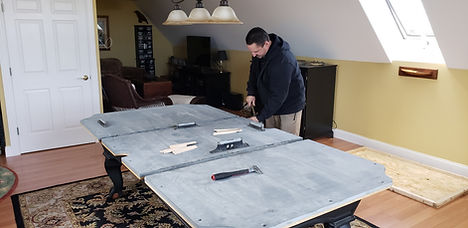 Maine Pool Table Services, Jeff Robitail, leveling out 3 piece pool table slate in clients home