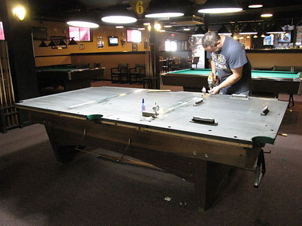 Jeff Robitialle working on pool table