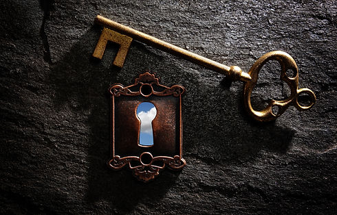 Vintage lock with blue sky and gold key
