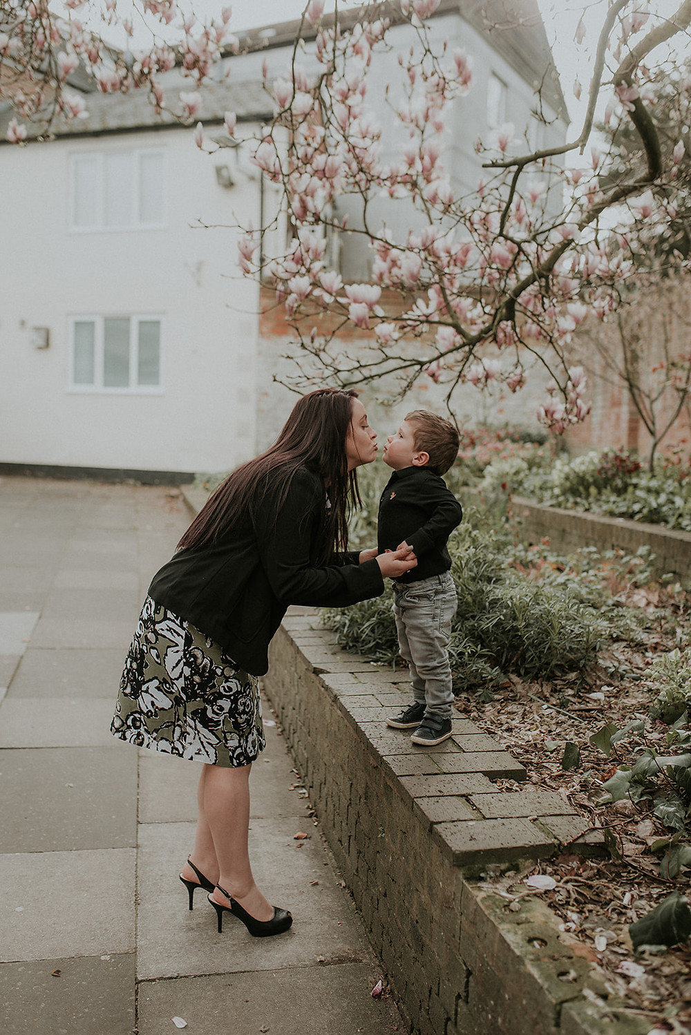 Mum and son kissing