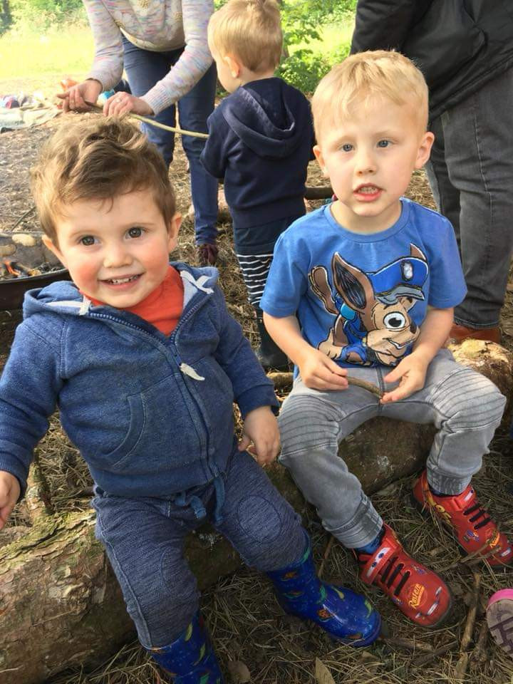 Brothers sat on a log