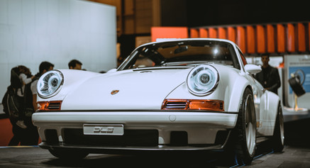 white-porsche-911-coupe-in-a-car-show-20