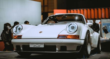 white-porsche-911-coupe-in-a-car-show-20