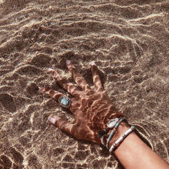 Touch the sand, feel the sea
