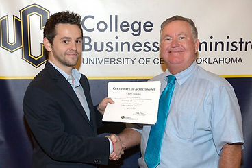 The 2011 UCO Guild Scholar Vilard Mullaliu and Dr. Tom Guild. The endowed Guild Scholarship is awarded each year through the College of Business Adminsitration/College of Liberal Arts at the University of Central Oklahoma