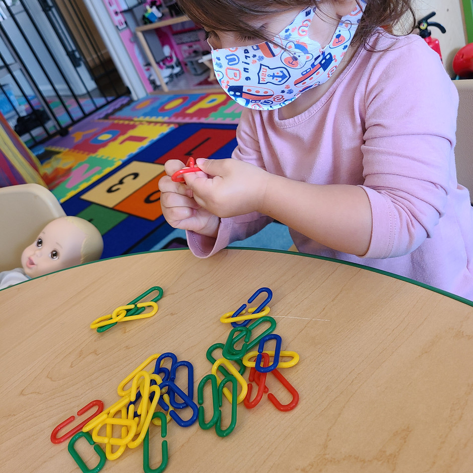Fine motor play with math links.