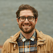 casual headshot of guy in glasses