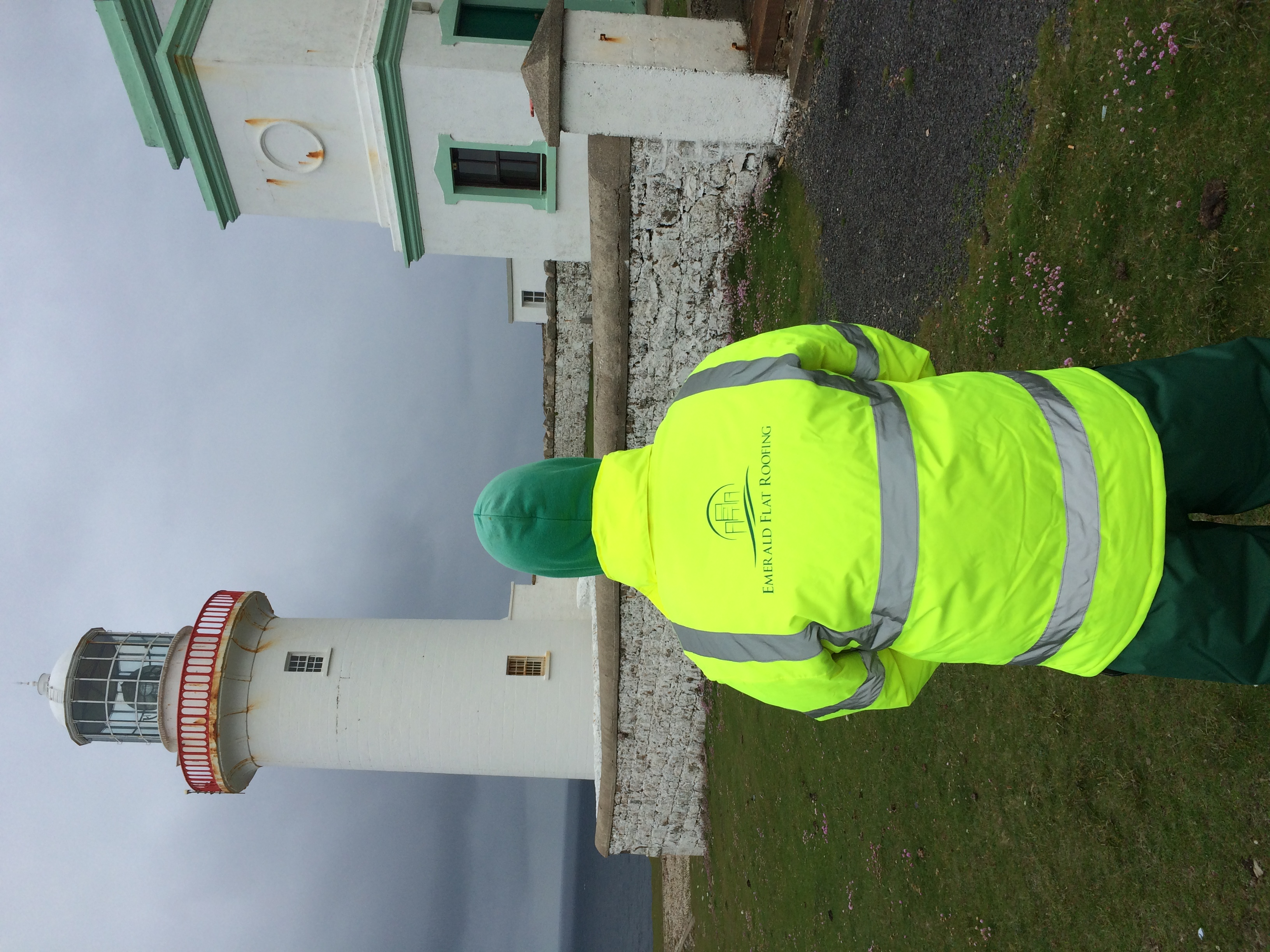 Logo Jacket Beside Lighthouse