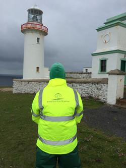 Logo Jacket Beside Lighthouse