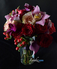 Bridesmaids bouquet in purple and red.jp