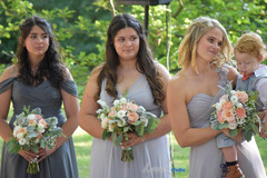 Bridal party with peach bouquets.jpg