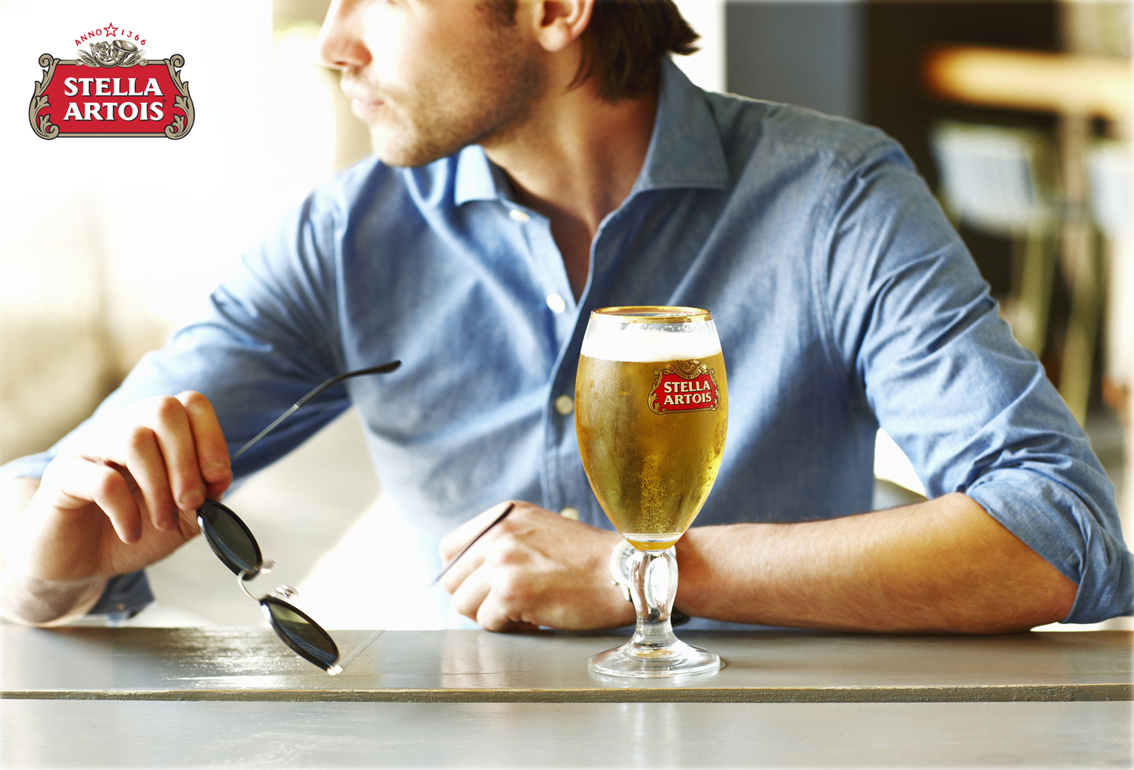 Stella Artois_Man&Glass_Logo