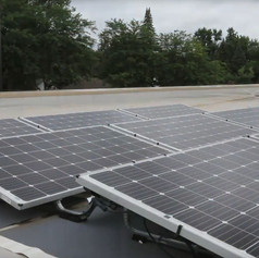 Less accessible features, like solar panels and the section of green roof are visble thanks to a periscope made by students as part of the curriculum, and shared with the entire school