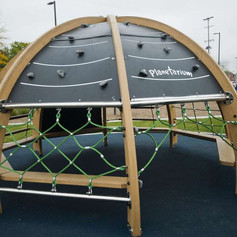 Even playground equipment, like this planetarium climbing structure, encourages kids to think about educational concepts